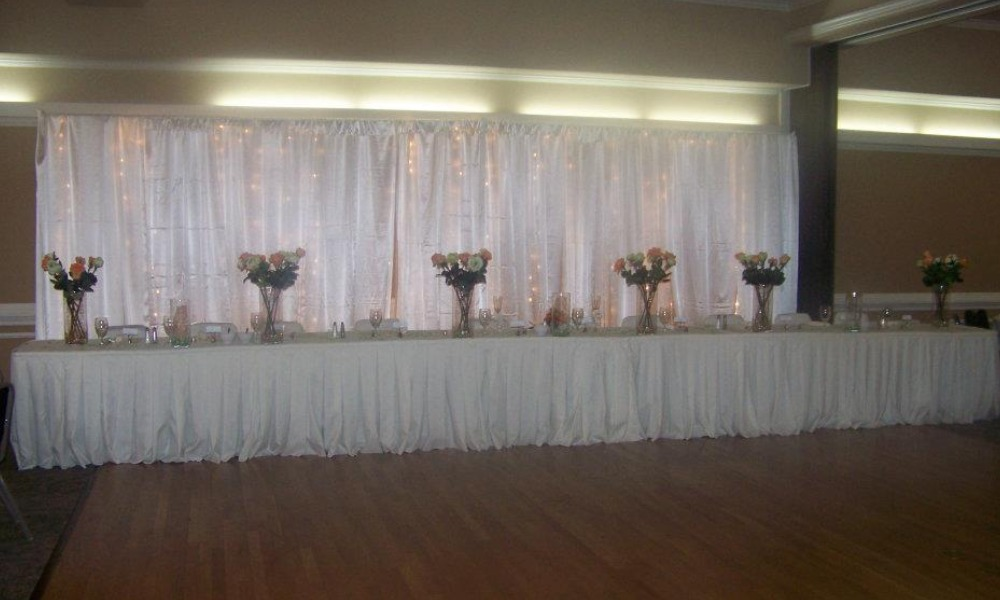 white tables with flowers